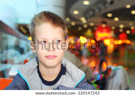 handsome little boy on a christmas fair
