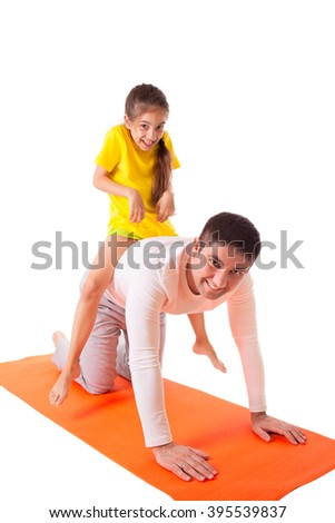 Handsome man father dad practicing yoga with his cute adorable beautiful daughter isolated on white background riding child on his back