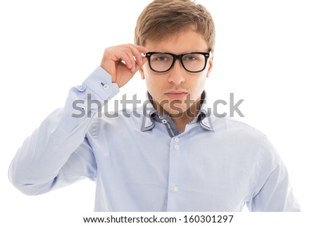 Handsome man in a blue shirt and glasses over a white background