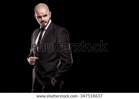 Handsome man in a suit on a black background