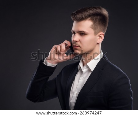 Handsome Man In Suit With Phone