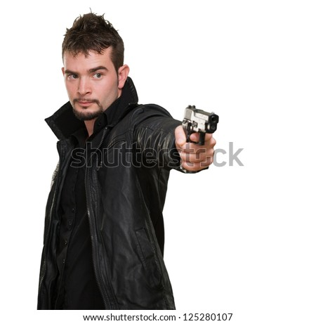 handsome man pointing with gun against a white background
