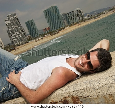 Handsome man relaxing near the sea
