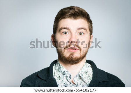 Handsome man surprised, isolated on background