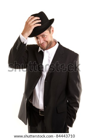 Handsome man with hat is smiling and saluting