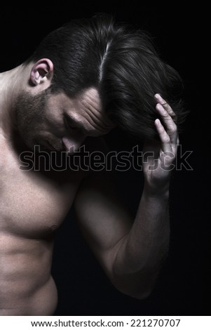 Handsome man with muscles with hand in his hair