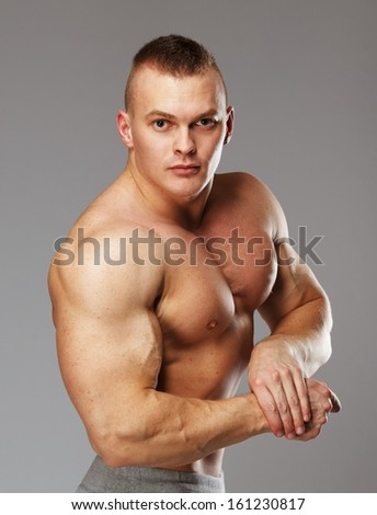 Handsome man with muscular torso posing