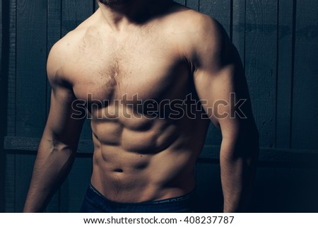 Handsome man with sexy muscular body and bare torso. Beauty and health, sports