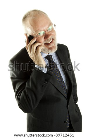 Handsome mature business man is having pleasant phone call on white background