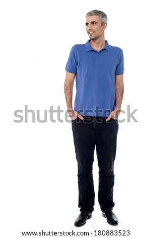 Handsome middle-age man looking away, hands in pockets