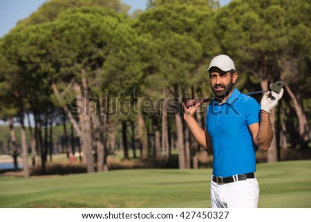 handsome middle eastern golf player portrait at course at sunny day