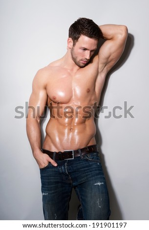 handsome muscular man on grey background