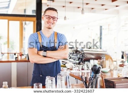 handsome restaurant owner standing in front of the coffee bar