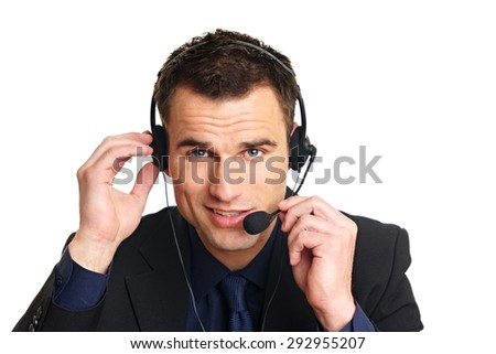 Handsome smiling customer service operator with headphones on his head