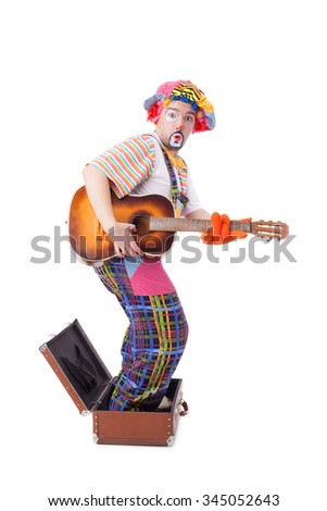 handsome young clown with the guitar and trunk