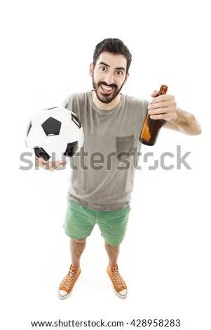 Handsome young man holding ball and beer on white background