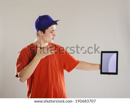 Handsome young man with digital tablet isolated in studio
