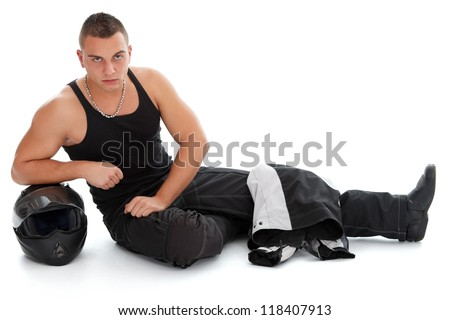 Handsome young man with motorcycle helmet, studio shot