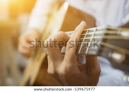Handsome young men playing Practicing guitar lesson,selective focus,vintage color