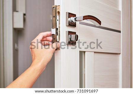 Handyman Repair The Door Lock In The Room, Man Fixing Lock With  Screwdriver, Close