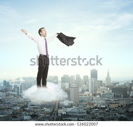 happiness businessman on cloud and city