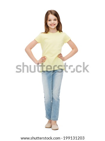 happiness, childhood and people concept - smiling little girl in casual clothes