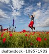 Happiness girl in jump among red poppy - stock photo