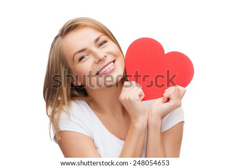 happiness, health and love concept - smiling woman in white t-shirt with heart