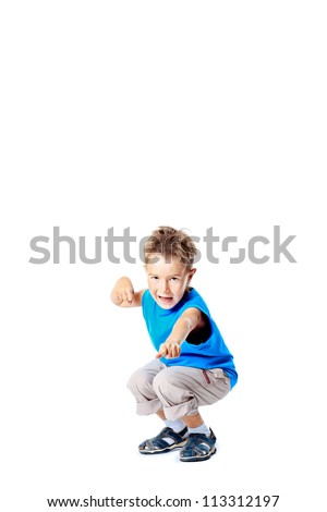 Happy active boy posing at studio. Isolated over white.