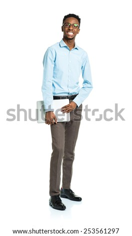 Happy african american college student standing with laptop on white background