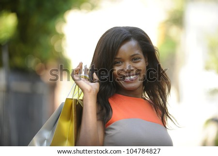 happy african american with shopping bags