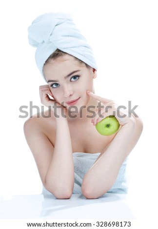 Happy and Healthy teen, natural organic raw fresh food concept / portrait of attractive smiling girl holding green apple in her hand over white background