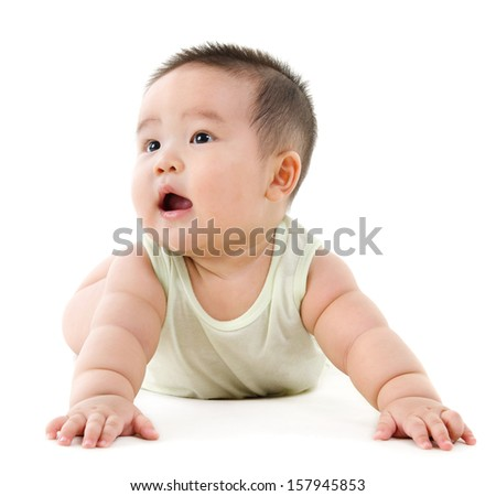 Happy Asian baby boy looking up and smiling. Full body crawling on floor, isolated on white background.