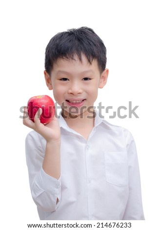 Happy Asian boy with apple, isolated on white background