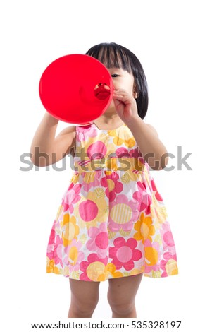 Happy Asian Chinese little girl holding retro loudspeaker in isolated white background.