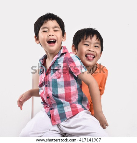 Happy Asian family boys and mother isolated in White background