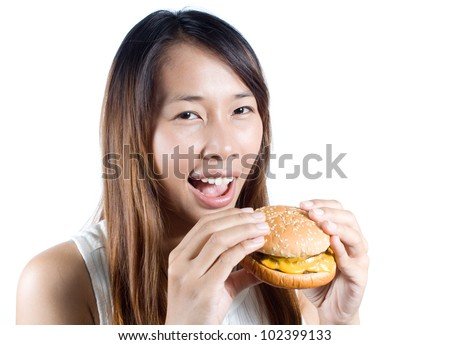 Happy asian woman  with  her cheeseburger on  white background