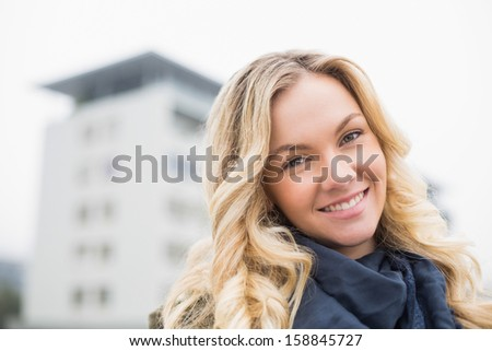 ... attractive blonde posing outdoors on urban background - stock photo