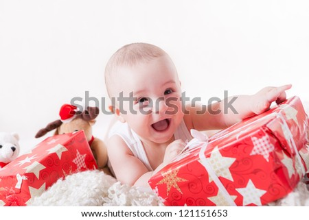 Happy baby with presents