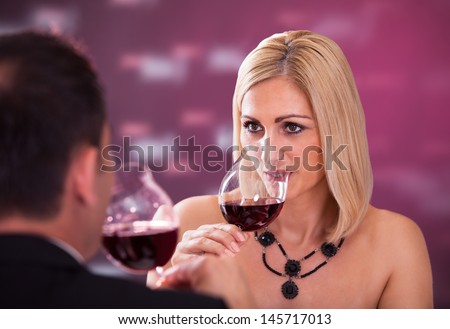 Happy Beautiful Couple Enjoying Meal And Wine In Restaurant