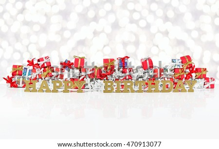 Happy birthday golden text on the background of red and silver gifts on a bokeh background