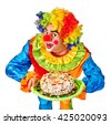 Happy birthday wig funny clown keeps cake.  Isolated. - stock photo