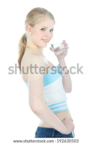 Happy blonde teenage girl with glass of clear water over white background