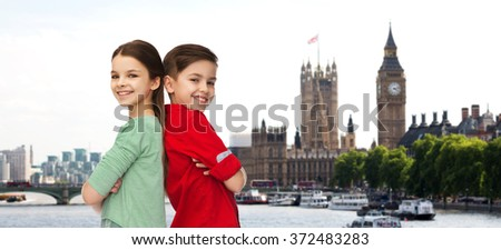 happy boy and girl standing together over london
