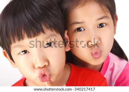 Happy boy and girl with piggy face isolated