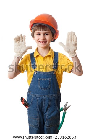 Happy boy in building helmet with open palms, isolated on white background