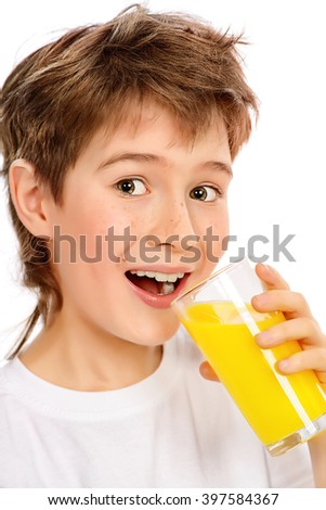 Happy boy is drinking fresh orange juice. Isolated over white.