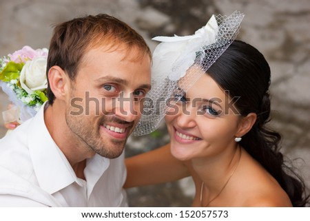 Happy bride and bridegroom are hugging