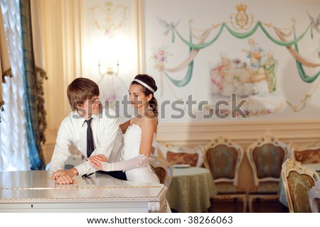 happy bride and groom near the piano