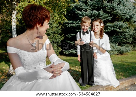 Happy bride at a wedding with children. Family values.